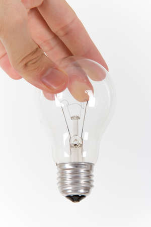 Hand holding light bulb from top on white background. Stock Photo - 22623237