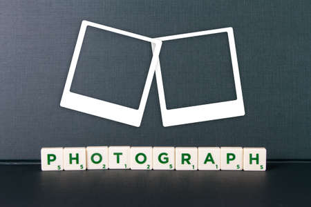 Photography word in scrabble letters and white photo frames. photo