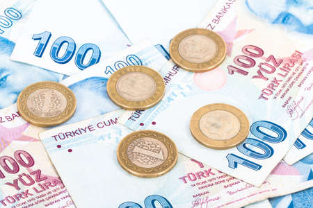 Close up view of one hundred Turkish lira banknotes with coins. photo