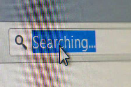 address bar: Close up macro of internet browser address bar with searching text selected with mouse arrow pointer. Stock Photo