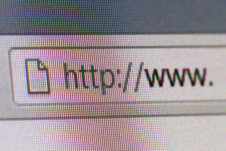 conputer: Close up macro of conputer screen internet browser address bar world wide web text.