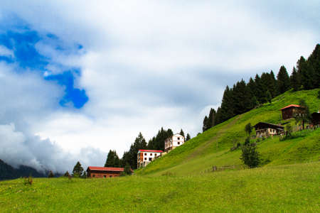 Mountain houses with beautiful sky in Ayder Plateau, Rize, Turkey.