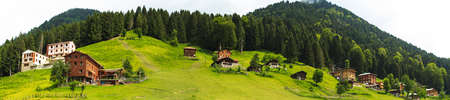 Panoramic view of mountain houses in Ayder Plateau, Rize, Turkey.