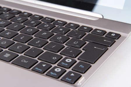 Laptop keyboard focused on enter key. photo