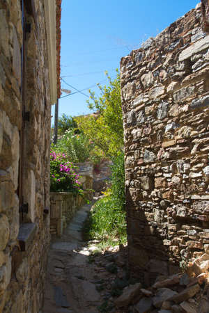Stone buildings, old Turkish village of Doganbey, Turkey. photo
