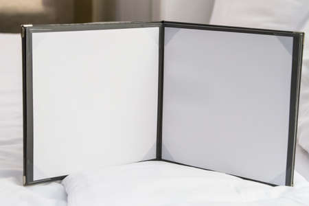 Blank white note paper, sheets on bed in hotel room. Stock Photo - 22712883