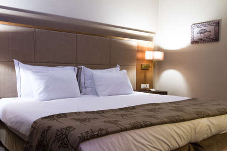 Interior of modern hotel bedroom with glowing lights. Stock Photo - 22721375