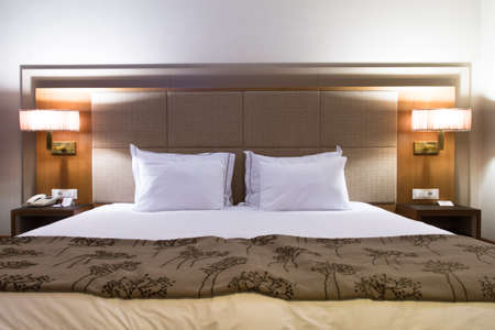 Interior of modern hotel bedroom with glowing lights. Stock Photo - 22721387