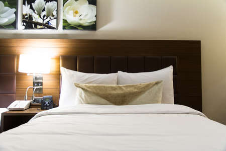 Interior of modern hotel bedroom and glowing light. Stock Photo - 22721424
