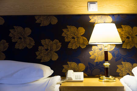 Interior of modern hotel bedroom with glowing light. Stock Photo - 22721428