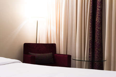Inter of modern hotel bedroom and red comfortable set with glowing light. Stock Photo - 22721446