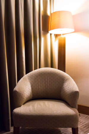 Interior of modern hotel bedroom. Seat for relaxion and glowing light behind. Stock Photo - 22721468