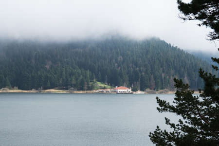 foggy hill: Landscape view of lake with mystical foggy hill in Lake Abant, Bolu, Turkey.