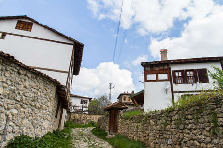 Traditional ottoman house from Safranbolu, Turkey with white cloudy sky. photo