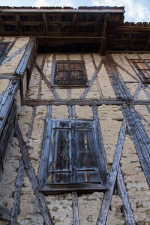 Wooden windows of old style traditional house and bright weather. photo