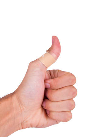 band aid: Adhesive bandage, plaster on thumb, isolated on white background.