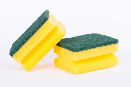 Close up view of yellow kitchen cleaning sponge, isolated on white background. photo