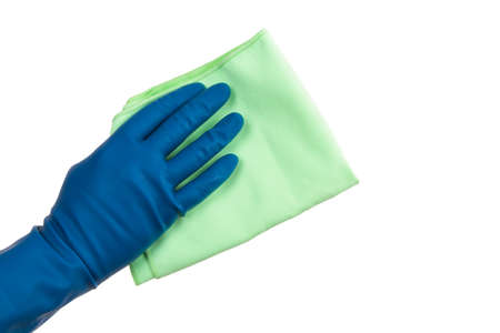 Hand in glove holding green rag, isolated on white background. photo