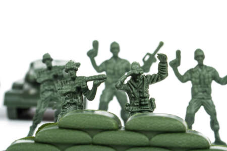 plastic soldier: Miniature toy soldiers, isolated on white background.