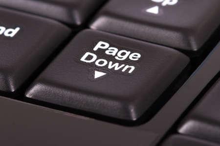 page down: Page down key on black keyboard.