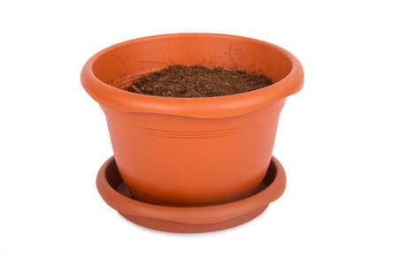 Flower pot with full of soil, isolated on white background. Stock Photo
