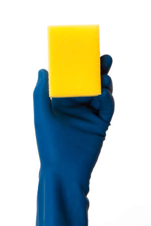 Hand in glove holding sponge,  isolated on white background. photo