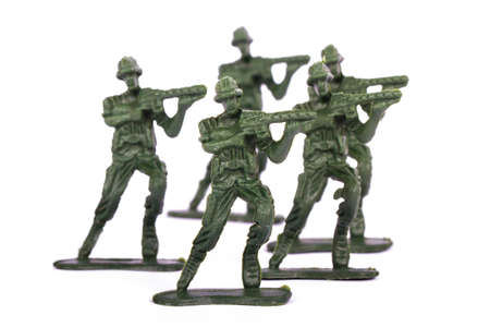 Group of attackers, miniature toy soldiers, isolated on white background.