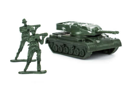green plastic soldiers: Miniature toy tank and attacker soldiers, isolated on white background. Stock Photo