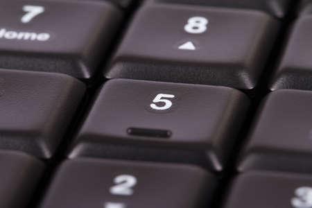 numpad: Black computer keyboard keys on numpad area. Stock Photo