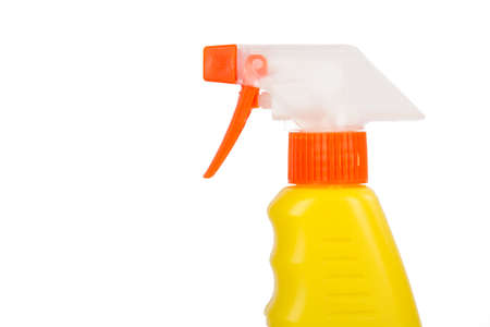 Yellow spray bottle for cleaning, isolated on white background. photo