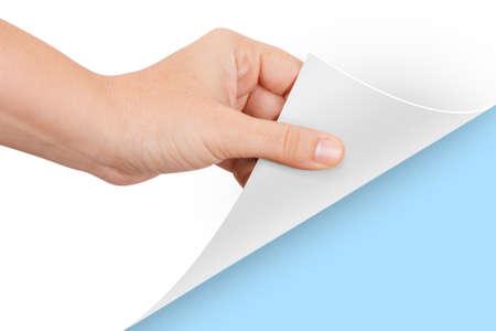 Blauwe kleur achter papier, met de hand draaiende pagina. Stockfoto
