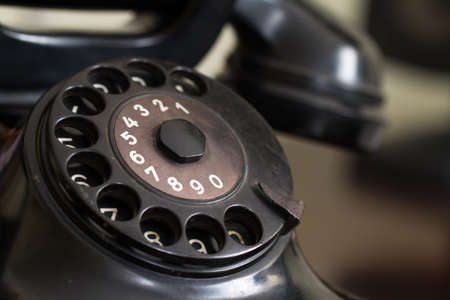 Black retro phone on blurry . photo