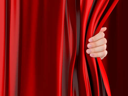 Hand opening red curtain. photo
