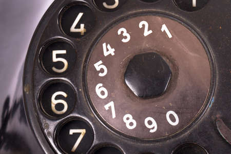 Close up view, rotary dial of black vintage phone. photo