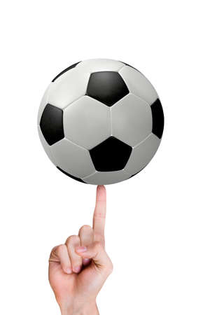 Index finger of hand with football. Stock Photo