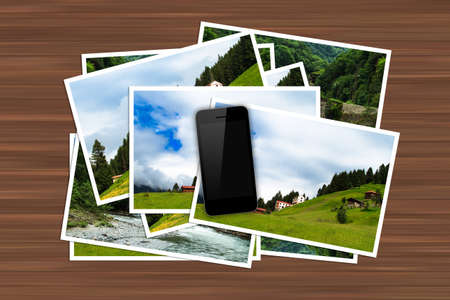 Blank screen smart phone on natural pictures on wooden table. photo