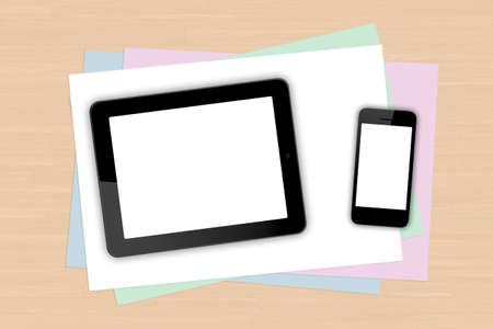 Digital tablet and smart phone with blank white screen on colorful note papers on wooden table. photo