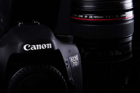 ISTANBUL, TURKEY - JANUARY 04, 2014: Photo of Canon containing 7D body and  24-105mm zoom lens on dark background. Stock Photo - 29853093