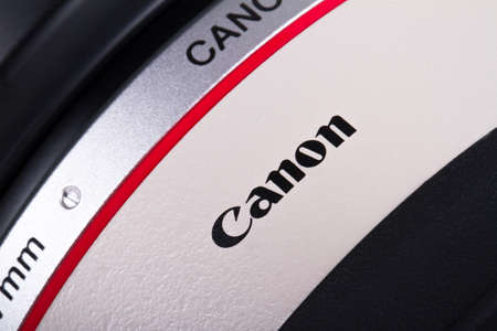 ISTANBUL, TURKEY - MAY 19, 2014: The logo of the brand Canon on lens.
