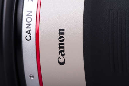 tele up: ISTANBUL, TURKEY - MAY 19, 2014: The logo of Canon on lens. Editorial