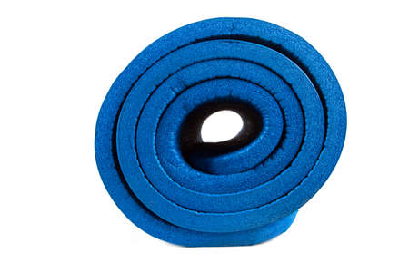 Side view of rolled blue yoga mat, isolated on white background. photo