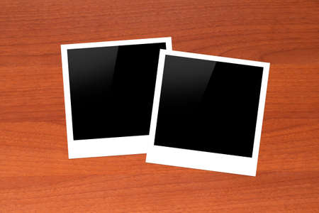 Blank, black picture frames with copy space on wooden table. photo