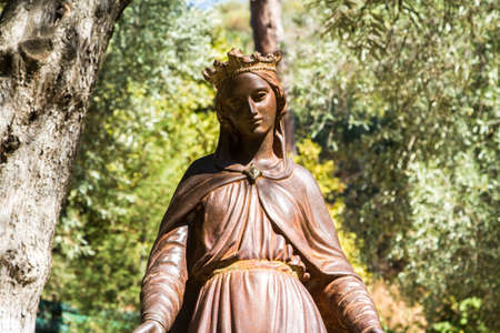jesus standing: Front view of bronze statue of Virgin Mary in natural place. Stock Photo