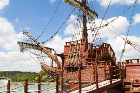 forefront: Forefront of pirate ship in park on cloudy background.