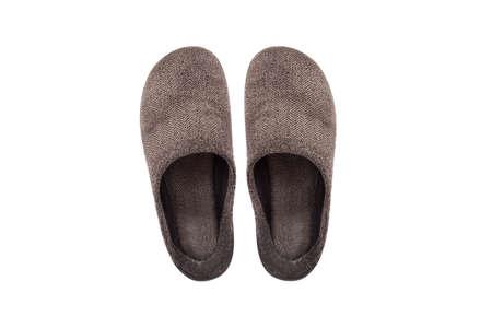 slipper: Brown indoor slipper isolated on white background. Stock Photo