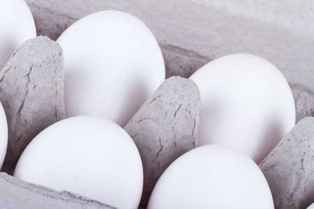 close up view: White eggs in carton with detailed close up view. Stock Photo