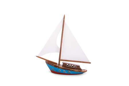 Front view of close up wooden sailboat toy with white sail, isolated on white background. Stock Photo