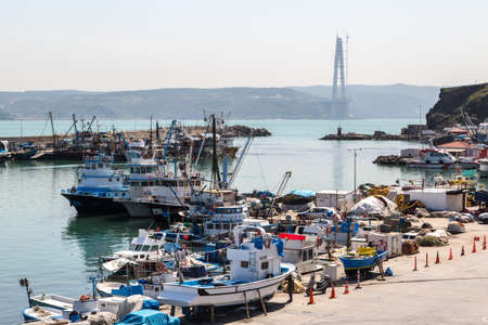 istanbul beach: ISTANBUL, TURKEY - APRIL 12, 2015: Top view of fishing boats, fishermen with their nets and ropes.
