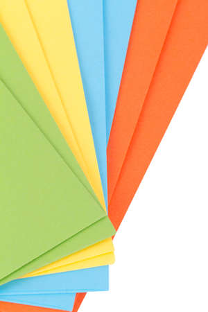 heap up: Close up detailed top view of heap of multicolored envelopes on end, isolated on white background.