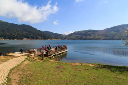 BOLU, TURKEY - MAY 10, 2015 : People standing on a pier and wathching the coastline view of Abant Lake which is at 1350 m high from ground in Bolu Turkey. Editorial